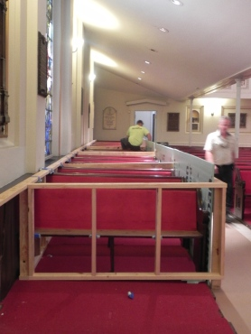 Pews that will remain during construction are being protected