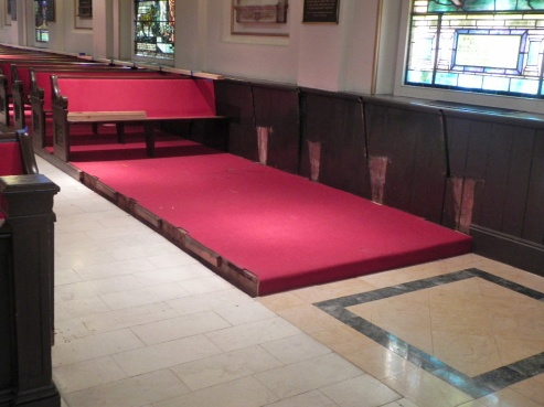 Pews have been removed to provide space for the universal access ramp