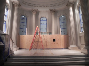 Wood frame protects the marble altar and rail. Staind glass windows are protected