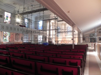 Scaffold reaches from sided to side and to the ceiling will provide a wall between the chancel (where most of the demolition dust will originate) from the rest of the nave.