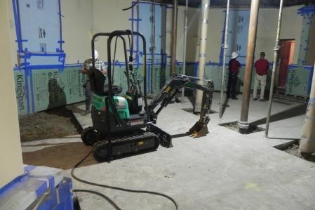 Excavator in the chapel