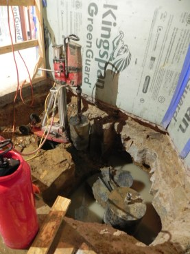 The old foundation is being cut to allow for the new footing