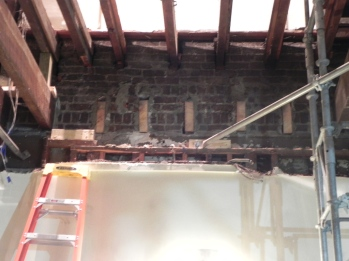 The inset ends of the old joists remain in the walls.