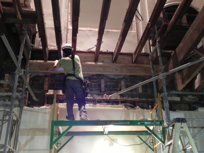 The plaster walls are supported by the joists and so they have to be supported before the rest can be cut off and removed
