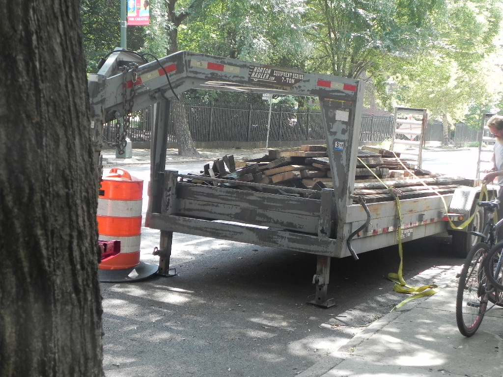 Wood from joists loaded and ready for a new use