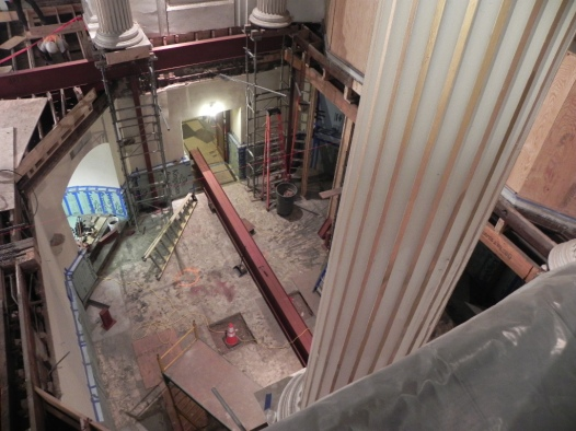 Steel framing has been partially installed with one beam on the chapel floor awaiting installation
