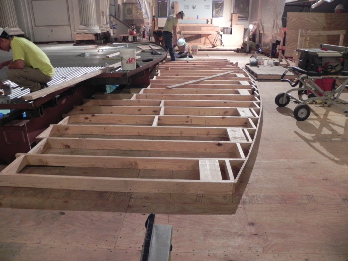 A view of the framing for the bottom step of the chancel