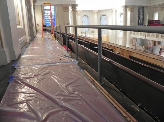 Steel railings installed behind the gallery pews