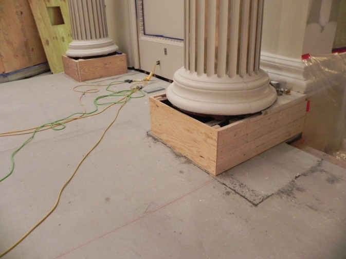 Wood framing has been installed around the base of the pillars ready for marble to be reinstalled