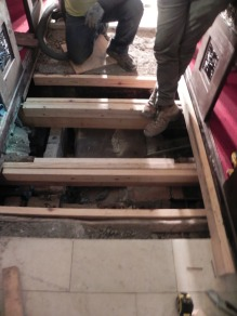 West aisle is being repaired to eliminate the low spot