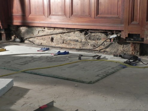 Original stone exposed by removal of the raised floor in the chapel.