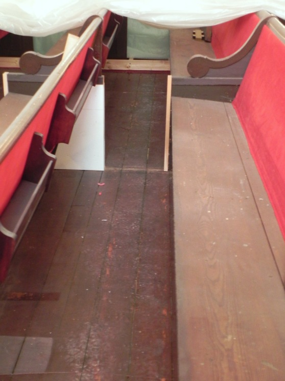 Pew supports are being reinforced where the dividers were removed