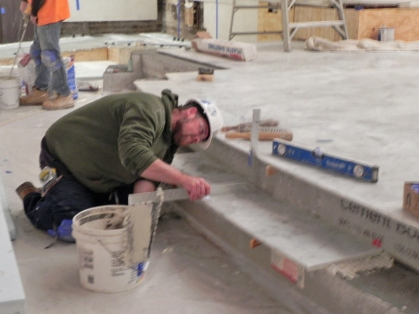 Measuring to cut the marble for the riser