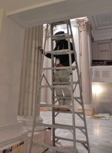 Painting the gold trim on a column