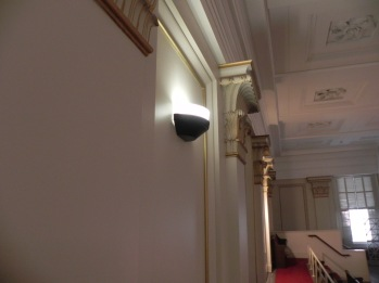 New sconce on gallery wall will match those below gallery and new torchieres