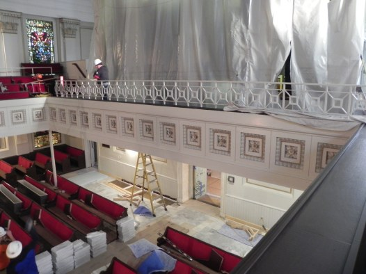 New railing along rear gallery wall