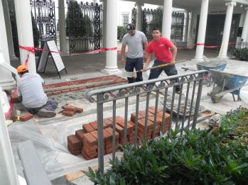 Brick being laid in front of portico