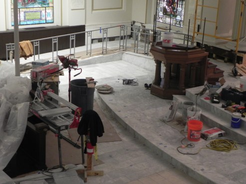 View of south east corner shows rail on handicap ramp and pulpit.