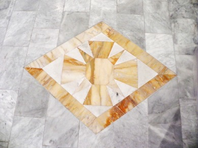 Original marble diamond has been cleaned and reset in the chancel floor