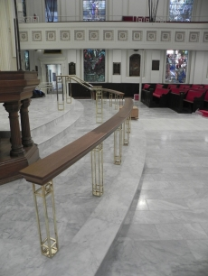 New communion rail in place. Handrails on chancel steps.